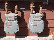 Exterior wall natural gas consumption meters. Two residential natural gas meters on exterior wall to measure household energy consumption Stock Photography