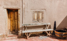 Exterior wall. With an old wooden bench Royalty Free Stock Image