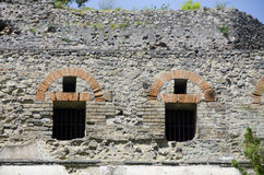 Exterior Wall, Windows and Doors at Pompeii, Italy. An exterior wall near the Porta Marina entrance in Pompeii showcase the amazing brick and rock work created stock photography