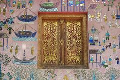 Free Exterior Wall With Beautiful Mosaic And Gold Painted Window Of The Pavilion At Xieng Thong Temple In Luang Prabang, Laos. Stock Photo - 50219190