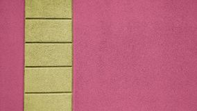 Exterior wall with yellow and magenta panels. Concrete wall with multicolored panels. Exterior architectural feature for background Royalty Free Stock Image