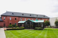 Exterior walls and garden including the glass prayer sanctuary of the Casey Solanus Center. Detroit, USA - October 2nd, 2016: Exterior walls and garden including royalty free stock photo