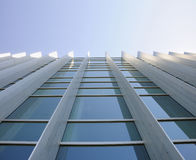 Exterior windows of building looking up Stock Photo