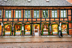 Exterior windows and facade of coffee shop where people rest and socialize during Christmas season Royalty Free Stock Image