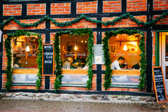 Exterior windows and facade of coffee shop where people rest and socialize during Christmas season Stock Photo