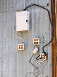 Exterior wiring nightmare. Exterior wiring that obviously predated the National Electrical Code Stock Image