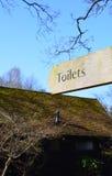 Exterior Wood toilet sign post Stock Photos