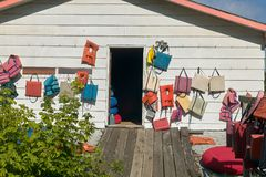 Exterior of a wooden clubhouse or store. Displaying life jackets and boating accessories on its wall Royalty Free Stock Image