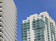 Exteriors of  luxury condominium towers in Miami Beach,Florida. Exteriors of two luxury condominium towers soaring high above street level in Miami Beach,Florida stock photo