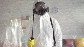 Exterminator busy working ,sprays chemical reagents close up