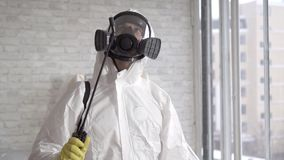Exterminator busy working ,sprays chemical reagents