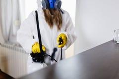 Woman exterminator working stock image