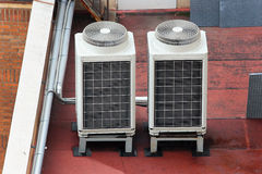 External air conditioning units on a roof top Stock Photo