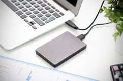 External Backup Disk Hard Drive Connected To Laptop Royalty Free Stock Images