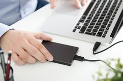 External backup disk hard drive connected to laptop Royalty Free Stock Photography