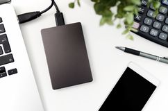 External backup disk hard drive connected to laptop Stock Photos