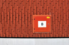 External cabinet for a fire hose. A red cabinet with a  'B' indicating it is a external cabinet containing a fire hose. This cabinet was situated outside a Stock Images