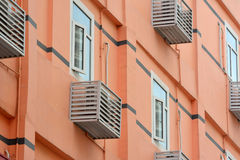 Residence building with air conditioner unit outside. External of colored residence building, with air conditioner unit outside, shown as featured residence Royalty Free Stock Photography
