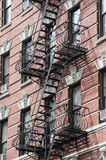 External fire escape staircase. On old brick building Royalty Free Stock Image