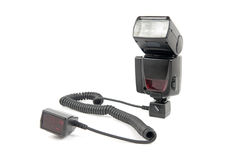 External flash connected to off-camera shoe cord Royalty Free Stock Photo