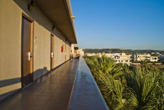 External gallery along Hotel Sun Beach Resort. Image is shot on the fourth floor of the hotel sun beach resort in ixia, rhodes early in the morning and showing Royalty Free Stock Image