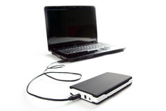 External hard disc connect to laptop. On white background Royalty Free Stock Image