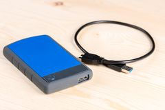 External hard disc hdd with usb cable on the wooden board table Royalty Free Stock Photo