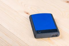 External hard disc hdd on the wooden board table with copy space.  stock photography