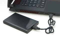 External hard disk connect to computer notebook. On white Royalty Free Stock Images