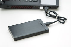 External hard disk connect to computer notebook. On white Royalty Free Stock Photo