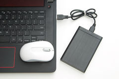 External hard disk connect to computer notebook. On white Stock Images