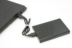 External hard disk connect to computer notebook. On white Stock Photos
