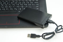 External hard disk connect to computer notebook Royalty Free Stock Photo