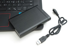 External hard disk connect to computer notebook. On white Royalty Free Stock Photos