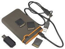 External hard disk drive and Usb flash on white. Background Stock Images