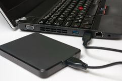 External hard disk HDD connected to laptop computer Royalty Free Stock Images