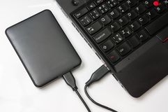 External hard disk HDD connected to laptop computer Stock Photography