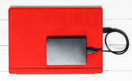 External hard disk on Red tablet computer. USB External hard disk on Red tablet computer Royalty Free Stock Images