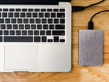 External hard drive connected to laptop computer Stock Photo