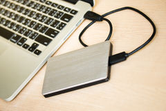 External hard drive connected to laptop computer Royalty Free Stock Image