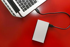 External hard drive connected to laptop Stock Photo