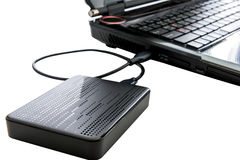 External hard drive connected to laptop Royalty Free Stock Photo