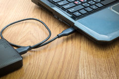 External hard drive connected to laptop Stock Photography