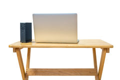 External hard drive and laptop on office desktop  on white. Royalty Free Stock Photography