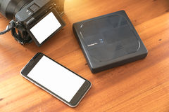 External hard drive wifi connected phone and photographer's came Stock Image