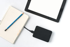 External hard drives, notebooks, iPads and then put on a white b. Ackground Royalty Free Stock Photos