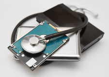 External hard drives and stethoscope Stock Images