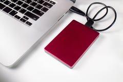 External harddrive connecteก to laptop. External hard drive connected to laptop Royalty Free Stock Photography