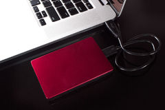 External harddrive connected to laptop. External hardisk connected to laptop Royalty Free Stock Photo