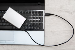 External HDD and laptop Stock Photos